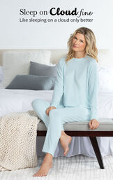 Model sitting on chair wearing Light Blue Cloud Fine Pajamas with the following copy: Sleep on Cloud fine, like sleeping on a cloud only better image number 2