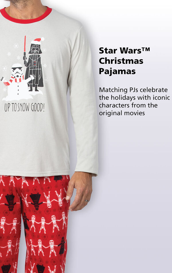 Graphic long-sleeve top reads ''Up To Snow Good'' while Darth Vader looms over a snowman Stormtrooper. Copy reads: Matching PJs celebrate the holidays with iconic characters from the original movies. image number 2