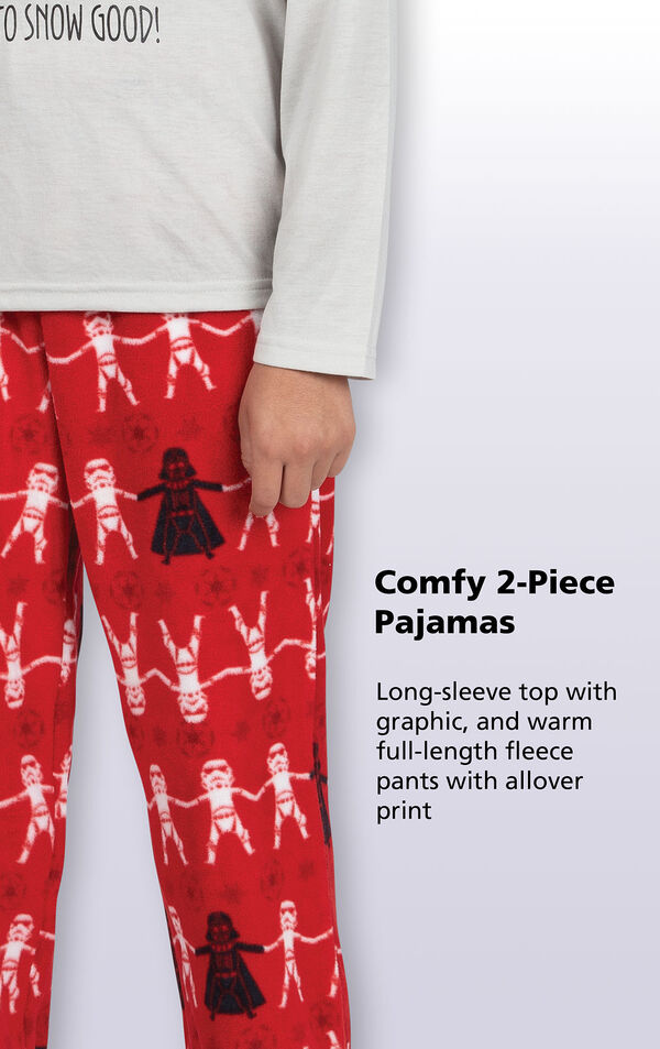 Red microfleece pants with a Darth Vader and Stormtrooper repeat pattern with the following copy: Long-sleeve jersey top with graphic and warm full-length fleece pants with allover print image number 3