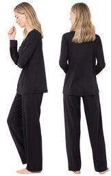 Model wearing Black Tie-Neck PJ for Women, facing away from the camera and then to the side image number 1