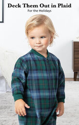 Infant boy wearing Heritage Plaid Infant Onesie Pajamas by bed with the following copy: Deck Them Out in Plaid for the Holidays image number 2