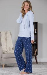 Model standing in living room wearing Blue Fleece Hoodie PJs image number 2