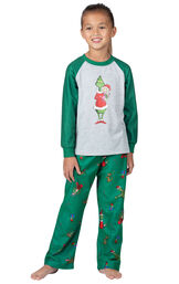 Model wearing Green and Gray Grinch PJ - Kids image number 0