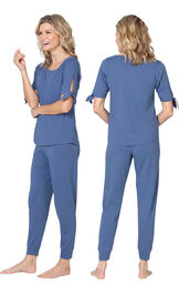 Model wearing Blue Tie Sleeve Jogger PJ for Women, facing away from the camera and then to the side image number 1