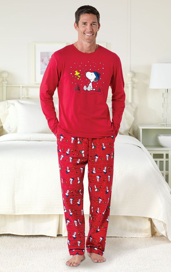 Model standing by bed wearing Red Snoopy and Woodstock Men's Pajamas image number 1