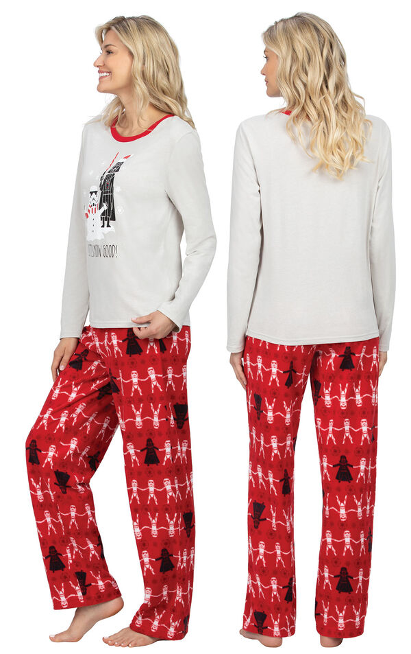 Model wearing Red Star Wars PJ for Women, facing away from the camera and then to the side image number 1