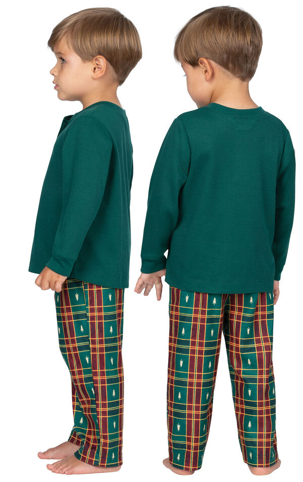 Model wearing Red and Green Christmas Tree Plaid Thermal Top PJ for Toddlers, facing away from the camera and then to the side image number 1