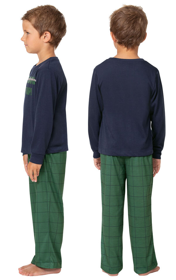 Model wearing Green Windowpane Check PJ with Graphic Tee for Youth, facing away from the camera and then facing towards the side image number 1