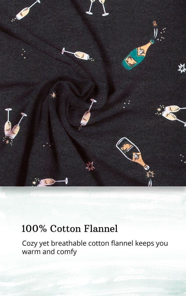 Black fabric with champagne bottle/glass print and the following copy: 100% cotton flannel: cozy yet breathable cotton flannel keeps you warm and comfy image number 4