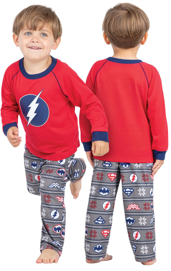 Model wearing Red and Blue Justice League PJ for Toddlers, facing away from the camera and then to the side image number 1