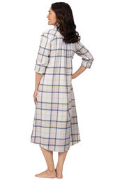 Model wearing Pink Plaid Gown for Women, facing away from the camera image number 1