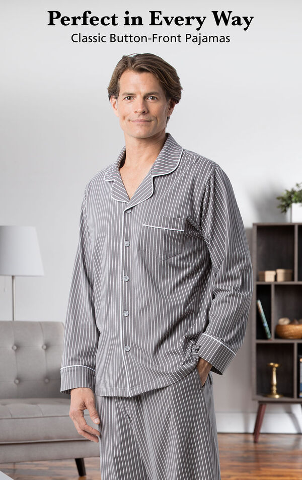 Model wearing Classic Stripe Men's Pajamas - Charcoal by a couch with the following copy: Perfect in Every Way - Classic Button-Front Pajamas image number 4