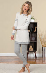 Model standing on a rug wearing Oatmeal Sweatshirt and Leggings Pajama Set for Women image number 2