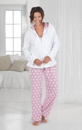 Model standing by couch wearing Pink and White Polka-Dot Snuggle Fleece Hoodie Pajamas image number 1