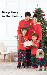 Family standing by Christmas Tree wearing Red and Blue matching Christmas Presents Family Pajamas with the following copy: Keep Cozy in the Family image number 1