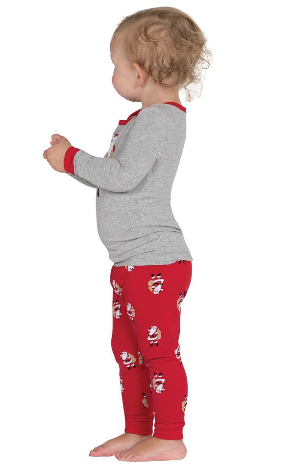 Model wearing Red and Gray St. Nick Infant Pajamas, facing to the side image number 1