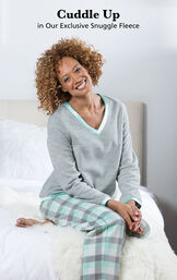 Model sitting on bed wearing Snuggle Fleece Plaid Pajamas - Aqua with the following copy: Cuddle Up in our Exclusive Snuggle Fleece image number 2