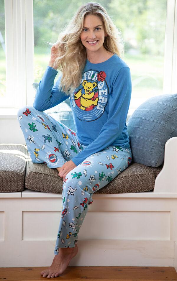 Woman sitting in bay window wearing Light Blue Grateful Dead Pajamas image number 2