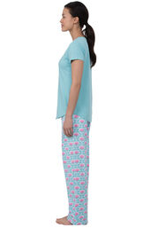 Model facing to the side wearing Aqua Floral V-neck Short-Sleeve PJ for Women with Modern Floral Full-length pants image number 2