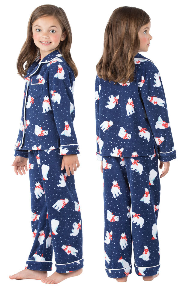Model wearing Navy Polar Bear Fleece Button-Front PJ for Girls, facing away from the camera and then facing to the side image number 1