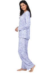 Model wearing Naturally Nude Long Sleeve Pajamas in Lavender Print, facing to the side image number 1