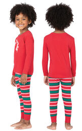 Model wearing Red and Green Christmas Stripe PJ for Toddlers, facing away from the camera and then to the side image number 1
