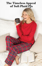 Model wearing Stewart Plaid Thermal-Top Women's Pajamas by bed with the following copy: The Timeless Appeal of Soft Plaid PJs image number 4