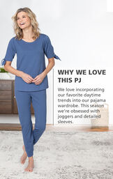 Model wearing Dusk Peekaboo Pajamas with the following copy: Why We Love This PJ: We love incorporating our favorite daytime trends into our pajama wardrobe. This season we're obsessed with joggers and detailed sleeves. image number 2
