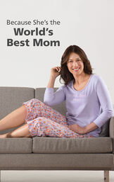 Model wearing World's Best Mom Pajamas sitting on couch with the following copy: Because she's the World's Best Mom image number 2
