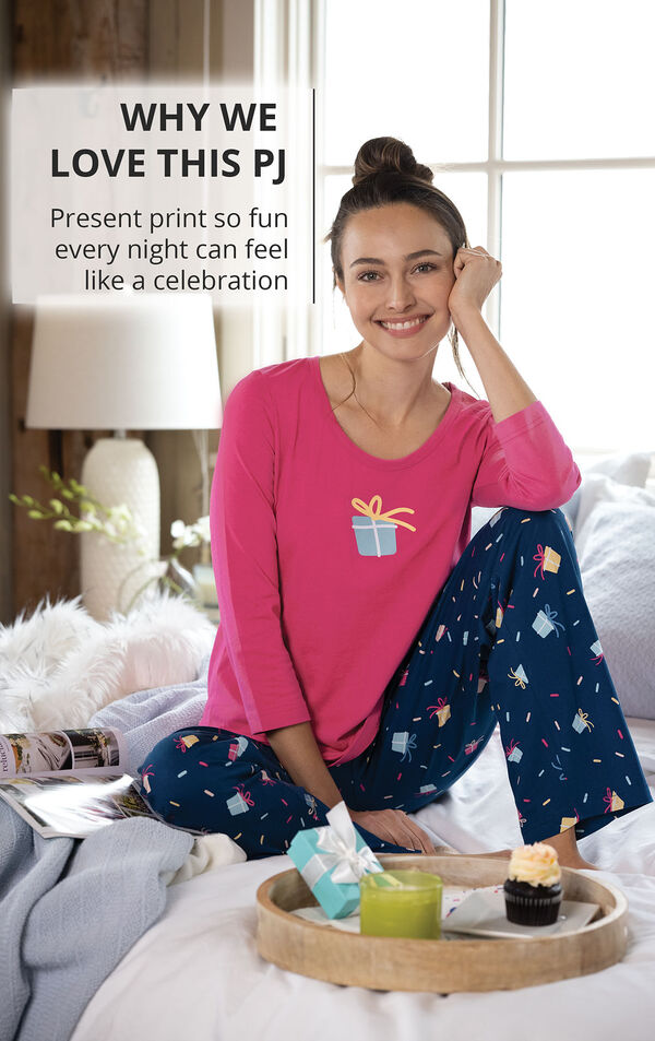 Model sitting on bed with the following copy: WHY WE LOVE THIS PJ Present print so fun every night can feel like a celebration image number 2