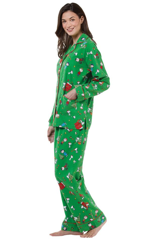 Model wearing Green with Red Trim Charlie Brown Christmas Women's Pajamas, facing to the side image number 2