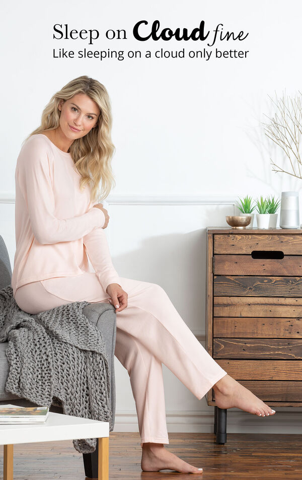 Model sitting on chair wearing Light Pink Cloud Fine Pajamas with the following copy: Sleep on Cloud fine, like sleeping on a cloud only better image number 2