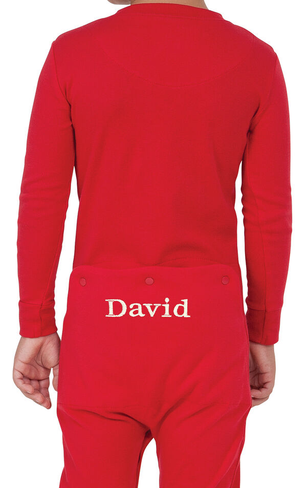 Model wearing Red Dropseat Onesie PJ for Youth, facing away from the camera image number 1