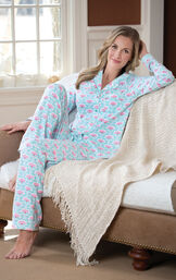 Model sitting on couch with blanket wearing Aqua and Hot Pink Modern Floral Boyfriend Pajamas image number 2