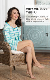 Model wearing Margaritaville Rest and Relaxation Short Set - Blue sitting on chair, with the following copy: Allover stripes in ocean blue blend timeless style with a tropical vibe image number 2