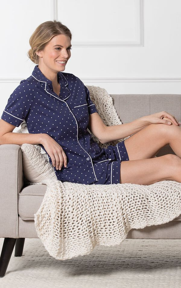 Model sitting on couch with blanket wearing Navy Classic Polka-Dot Short Set image number 2