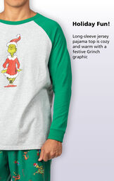 Close-up o f Dr. Seuss' The Grinch Men's PJs Gray and Green Top with the following copy: Holiday Fun! Long-sleeve jersey pajama top is cozy and warm with a festive Grinch Graphic image number 2
