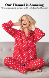 Model sitting cross legged wearing Red and White Polka-Dot Flannel Boyfriend Pajamas with the following copy: timeless pajama is made with soft, brushed flannel image number 2