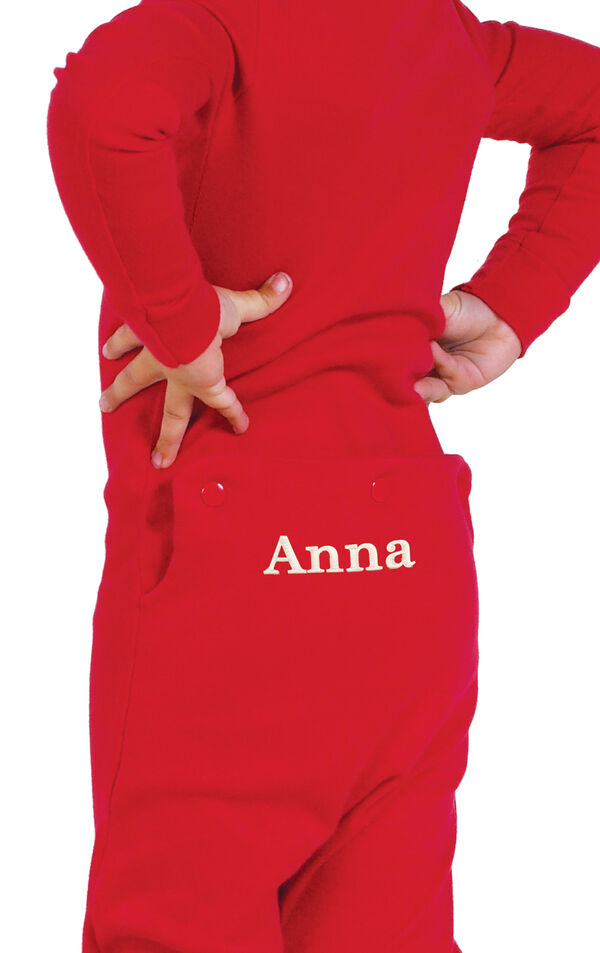 Model wearing Red Dropseat Onesie PJ for Infants, facing away from the camera image number 1