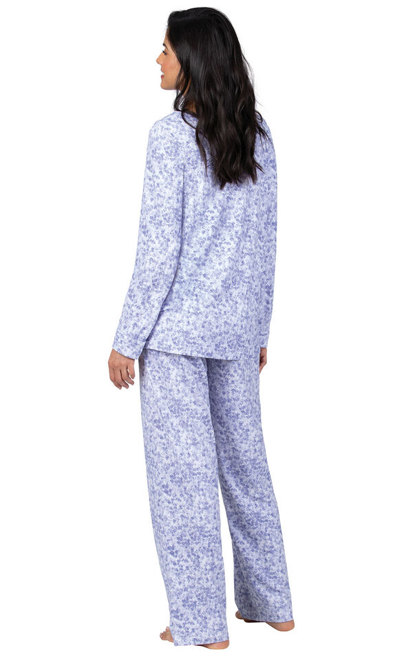 Model wearing Naturally Nude Long Sleeve Pajamas in Lavender Print, facing away from the camera image number 2