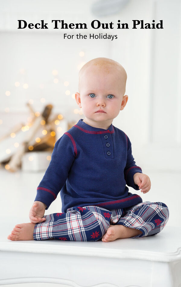 Infant sitting down wearing Snowfall Plaid Infant Pajamas with the following copy: Deck Them Out in Plaid for the Holidays. image number 1