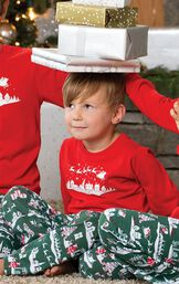 Toddler wearing The Night Before Christmas Pajamas, balancing presents on his head image number 1