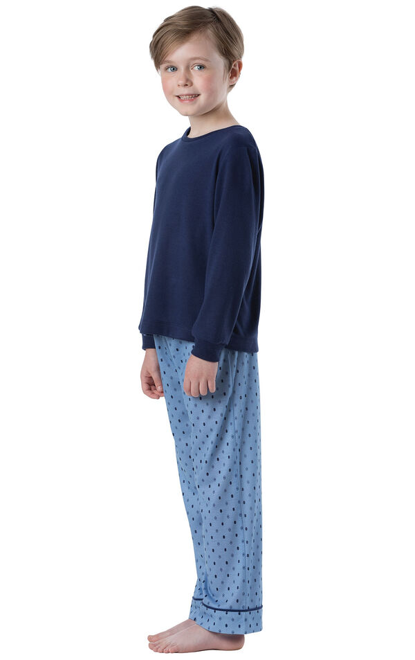 Model wearing Blue Geometric Pattern PJ for Youth, facing towards the side image number 2