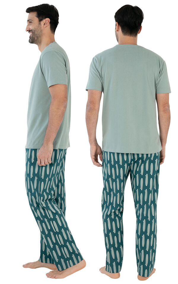 Model wearing Teal Surfboard Print Margaritaville PJ with Graphic Tee for Men, facing away from the camera and then to the side image number 1