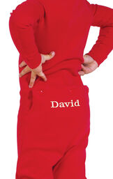 Model wearing Red Dropseat Onesie PJ for Toddlers, facing away from the camera image number 1