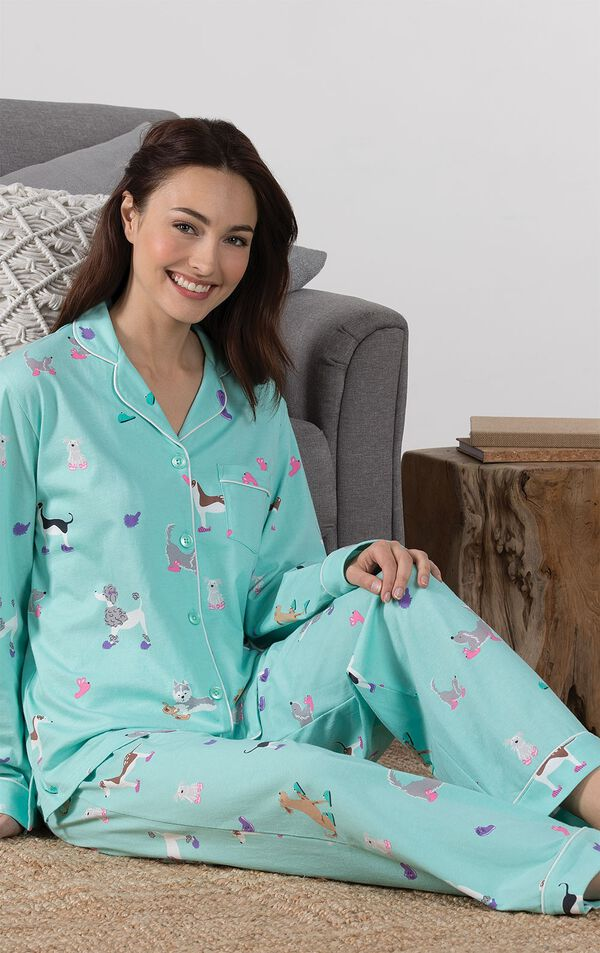 Model sitting on couch wearing Light Blue Dog Print Button-Front PJ for Women image number 3