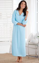 Model standing by couch wearing Light Blue with White Polka Dots Oh-So-Soft Pin Dot Nighty - Blue image number 1