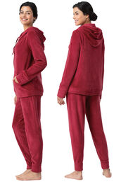Model wearing Deep Red Zip Front Hoodie Pajamas, facing away from the camera and then facing to the side image number 1