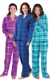 Models wearing Indigo Plaid Boyfriend Flannel Pajamas, Raspberry Plaid Boyfriend Flannel Pajamas and Wintergreen Plaid Boyfriend Flannel Pajamas.