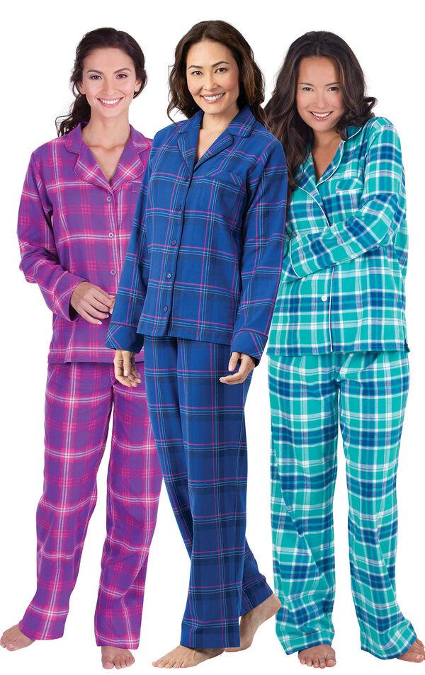 Models wearing Indigo Plaid Boyfriend Flannel Pajamas, Raspberry Plaid Boyfriend Flannel Pajamas and Wintergreen Plaid Boyfriend Flannel Pajamas. image number 0